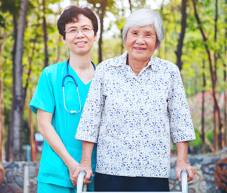 elderly and caregiver standing