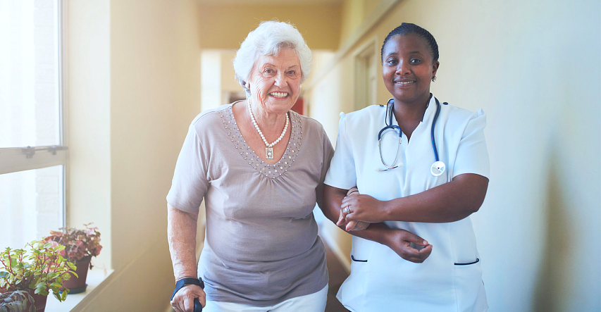 caregiver and elderly looking at the camera